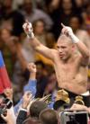 Cotto stops Judah in bloody 11 round battle