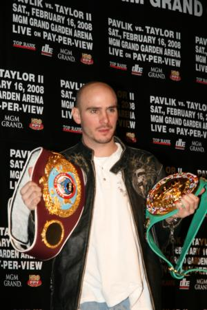 Kelly Pavlik proudly displays his middleweight championship belts.