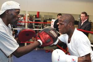 Roger and Floyd Maywather on the pads