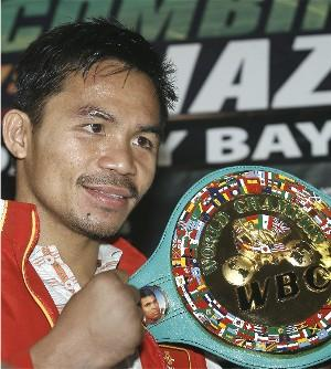 Pacquiao with his new WBC title belt: HoganPhotos.com