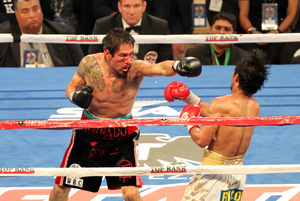 Although severely punished, a swollen and bloodied Margarito fought bravely. Photo by Tri Nguyen.
