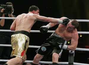 Huck(L) on the attack against Lebedev