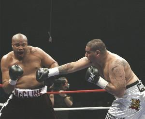 McCline meets Arreola's right hand: HoganPhotos.com