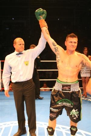 Green wins by 2nd round knockout