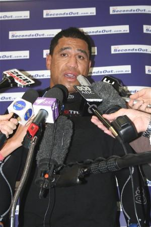 John Hopoate surrounded by the media