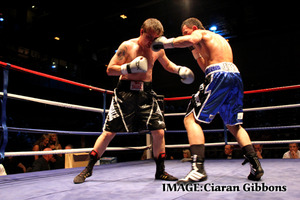 Evans in action against Shon Davies (Pic Ciaran Gibbons)