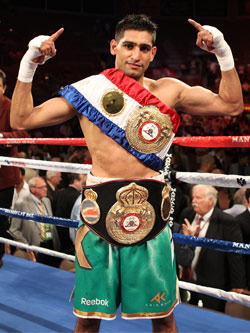 Khan stops Judah to add title (AP)