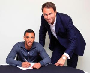Yafai signs with matchroom as Eddie Hearn looks on