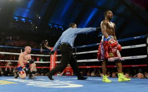 Broner walk away after knocking Reece down