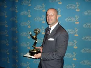 ...and poses with the Sports Emmy for Outstanding Sports Documentary.