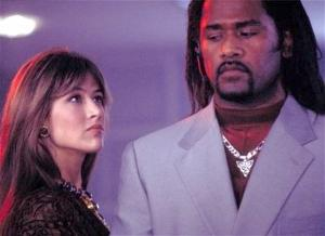 "John Seru with Sophie Marceau in ""The World Is Not Enough"""