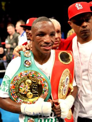 Devon Alexander shows off title belts