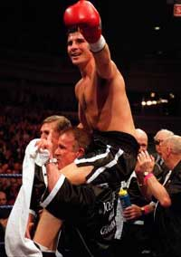 Proud father Enzo parades Joe around on his shoulders after a recent title defence.