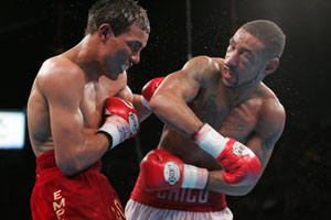 Corrales delivers a straight right hand to Castillo's chin (pic Tom Casino)